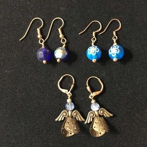 3 sets of blue earrings with angels